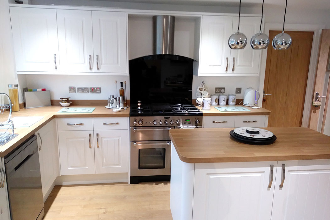 New kitchen fitted in white by NJC Construction Isle of Wight
